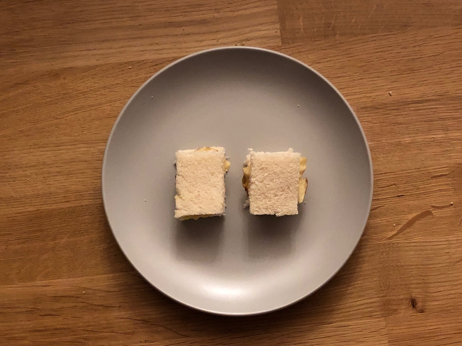 Overhead view of tiny white crisp sandwiches