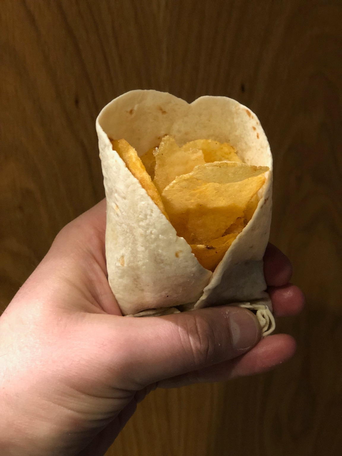 Potato crisps held in a tortilla wrap