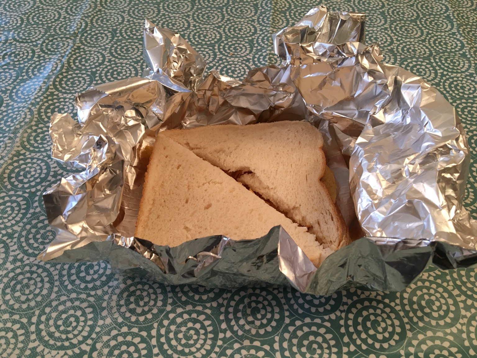 Crisp sandwich in foil, partially unwrapped